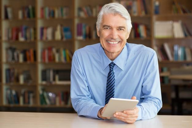 smiling-senior-businessman-using-digital-tablet_1262-2358.jpg